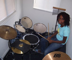 Girl Using Drums